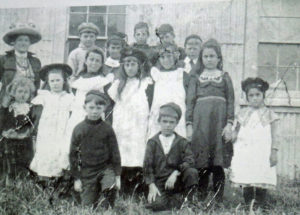 Mrs Hanna with her pupils outside the iron shed. The Vella sisters, Mattea and Antonia are on the right. Photo courtesy Kathleen Gibson, Seventy five Years 1904-1979