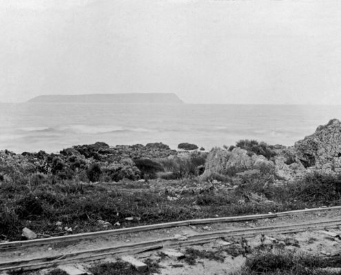 Tramway track running along the coast with Mana Island in the distance. Photo Courtesy: Allan Dodson