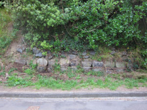 Stones which still block the very top of the tunnel at the south end of Moana Road near its junction with Motuhara Road Photo courtesy: Allan Dodson